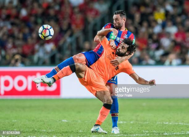 Liverpool FC forward Mohamed Salah fights for the ball with Crystal Palace defender Damien Delaney during the Premier League Asia Trophy match...