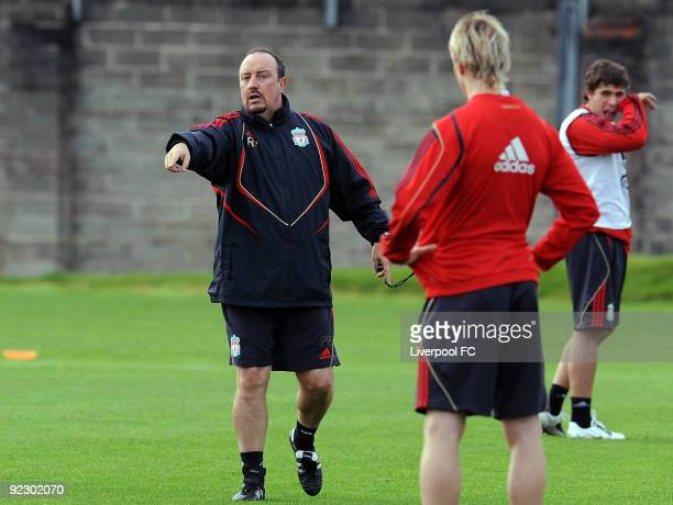 Liverpool FC head coach Rafael Benitez gives his players instructions during a Liverpool FC training session at the team's Melwood Training ground on...