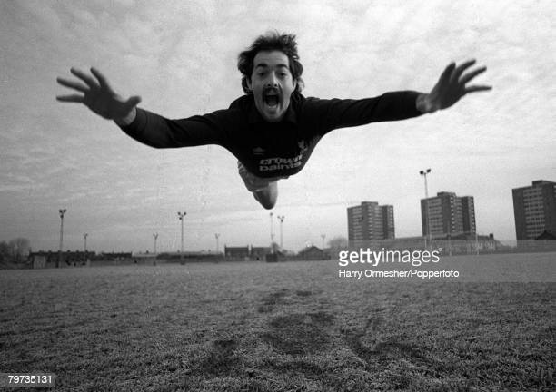 Liverpool FC keeper Bruce Grobbelaar appears to be mimicking Superman.while clowning around during a training session at Melwood, Liverpool, 1983.