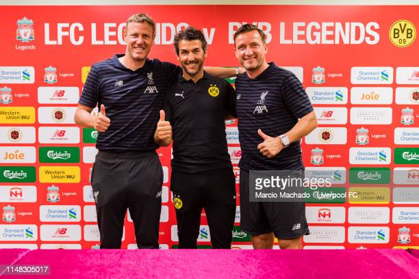 Liverpool FC Legend Vladimir Smicer BVB Legend KarlHeinz Riedle and Liverpool FC Legend Stephane Henchoz pose during a press conference ahead of...