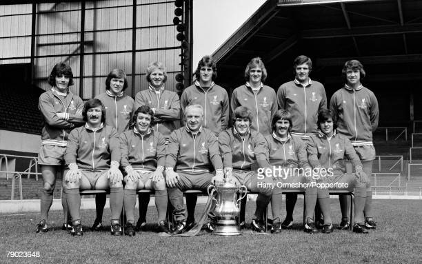 Liverpool FC line up for a team photograph alongside the FA Cup trophy at Anfield in Liverpool, England, circa August 1974. Back row : Kevin Keegan,...