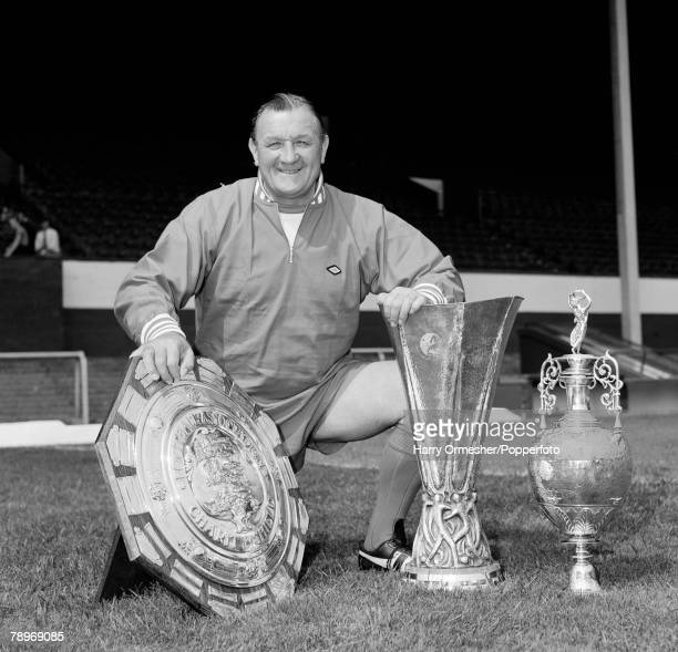 Liverpool FC manager Bob Paisley posing with the Charity Shield, UEFA Cup and League Championship trophies at Anfield in Liverpool, England, circa...