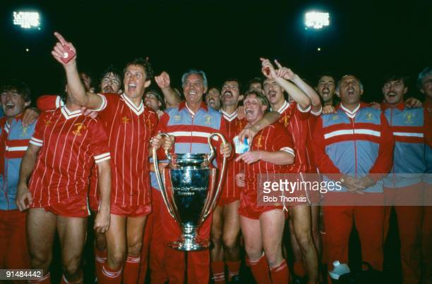 Liverpool FC manager Joe Fagan holds the European Cup surrounded by his players after they beat Roma 42 on penalties in the final at the Stadio...