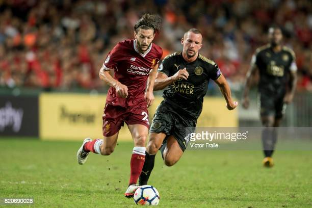 Liverpool FC midfielder Adam Lallana fights for the ball with Leicester City FC midfielder Daniel Drinkwater during the Premier League Asia Trophy...