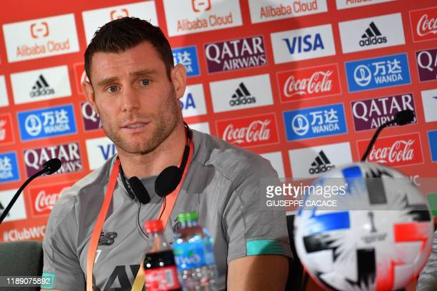 Liverpool FC midfielder James Milner gives a press conference on the eve of their 2019 FIFA Club World Cup semifinal match against Monterrey in Doha...
