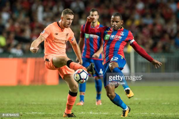 Liverpool FC midfielder Jordan Henderson fights for the ball with Crystal Palace midfielder Jason Puncheon during the Premier League Asia Trophy...