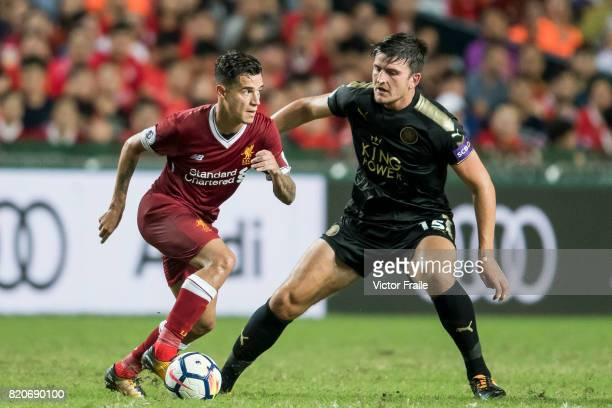 Liverpool FC midfielder Philippe Coutinho competes for the ball with Leicester City FC defender Harry Maguire during the Premier League Asia Trophy...