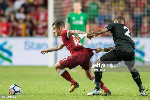 Liverpool FC midfielder Philippe Coutinho competes for the ball with Leicester City FC defender Danny Simpson during the Premier League Asia Trophy...