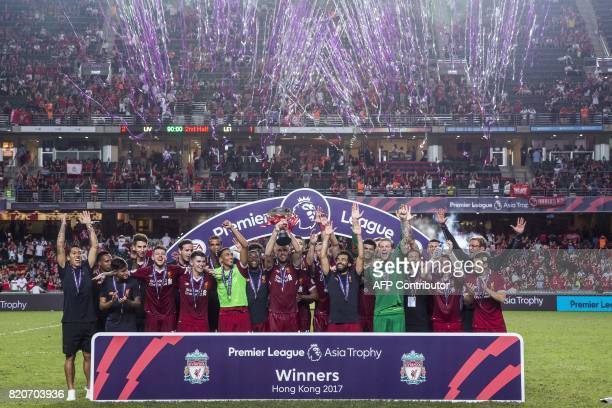 Liverpool FC players celebrate after beating Leicester City in the final of the 2017 Premier League Asia Trophy football tournament at Hong Kong...