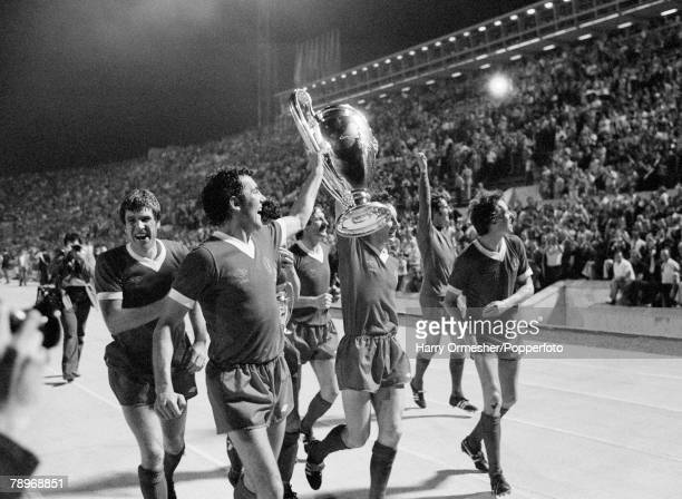 Liverpool FC players celebrate with the trophy after the European Cup Final between Liverpool and Borussia Monchengladbach at the Stadio Olimpico on...