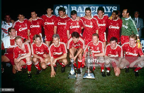 Liverpool FC players line up to pose with the league title after being crowned 1989/90 league champions after the Barclays League Division One match...