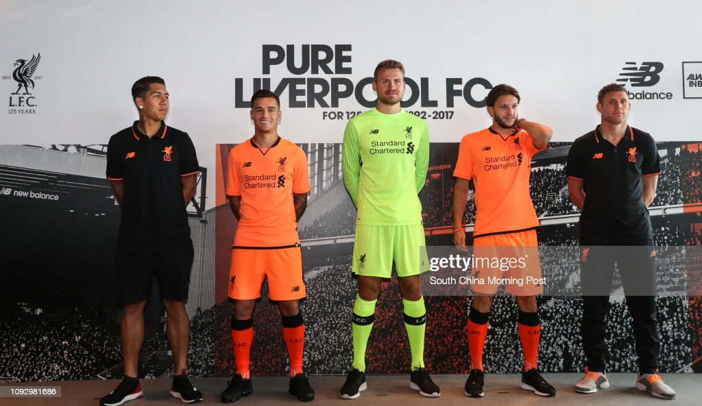 (Left to right) Liverpool FC players Roberto Firmino, Philippe Coutinho, Simon Mignolet, Adam Lallana and Vice-Captain James Milner wear the new Liverpool FC 2017/18 Third Kit by New Balance in their 125th Anniversary Year at the Ozone Bar in the Internat : News Photo