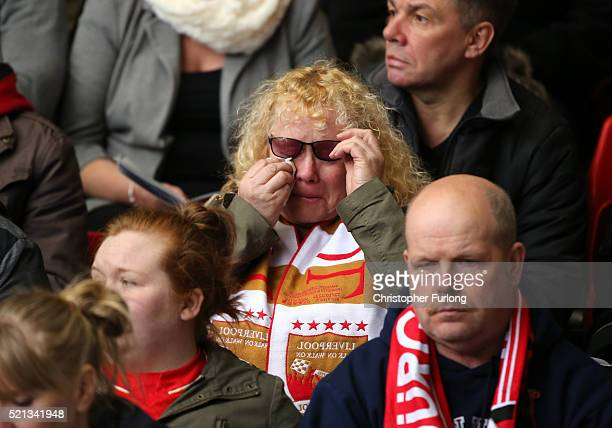 Liverpool FC supporter wipes tears from her eyes during a memorial service to mark the 27th anniversary of the Hillsborough disaster at Anfield...