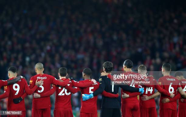 Liverpool FC take part in a minute of silence in honour of Remembrance Day prior to the Premier League match between Liverpool FC and Manchester City...