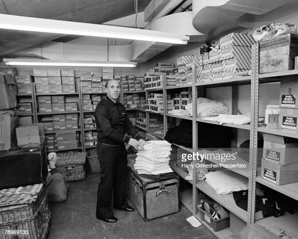 Liverpool FC trainer Ronnie Moran packing away towels in the kit room at Anfield in Liverpool, England, circa March 1976.