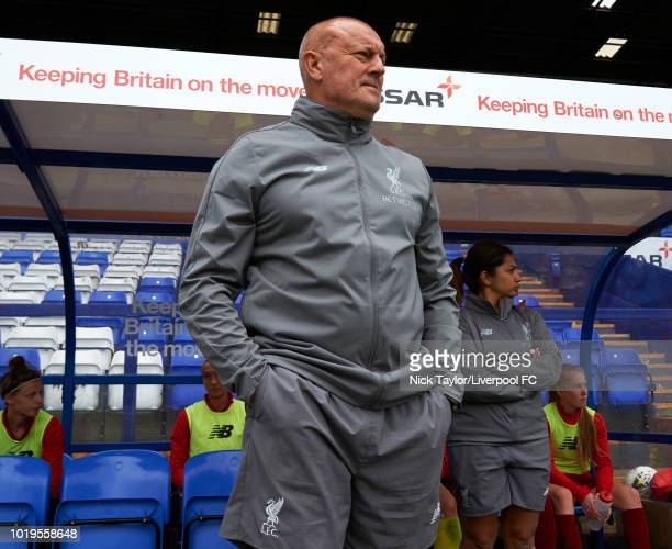 Liverpool FC Women manager Neil Redfearn watches the action from the dugout during the Liverpool FC Women v Manchester United Women game at Prenton...