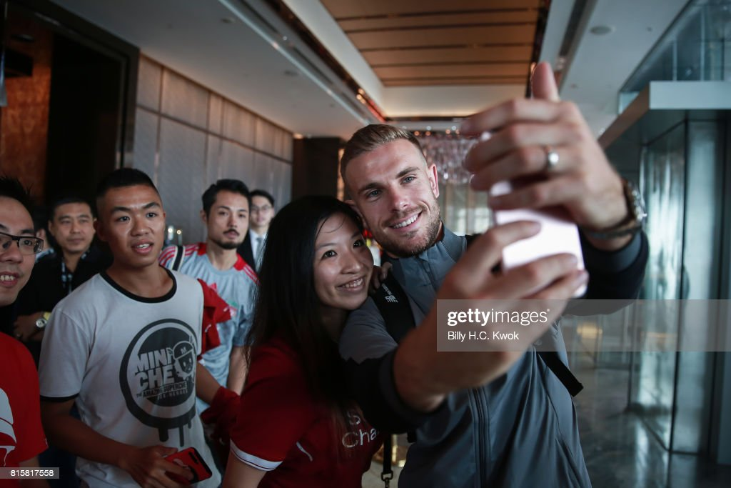 Liverpool FC's Jordan Henderson stops for a selfie with fans in Hong Kong on July 17, 2017 in Hong Kong. Crystal Palace, Leicester City and West Bromwich Albion will also compete in the tournament on 19 and 22 July at the Hong Kong stadium.