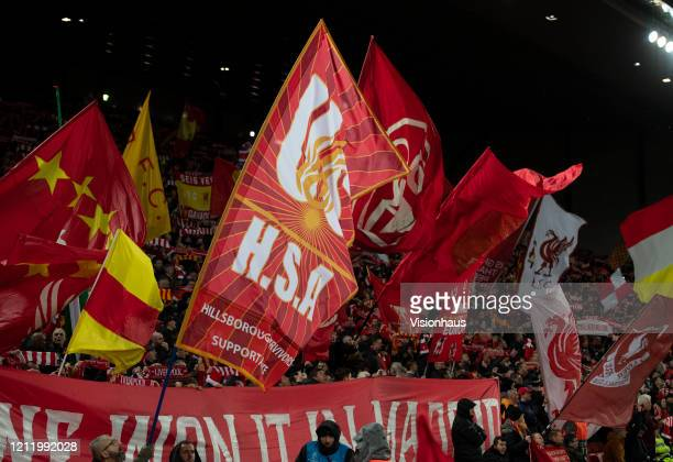 Liverpool flags being waved at the Kop End prior to the UEFA Champions League round of 16 second leg match between Liverpool FC and Atletico Madrid...