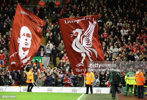 Liverpool flags depicting manager Rafael Benitez and the Liverpool crest in the stands