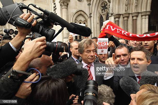 Liverpool Football Club Chairman Martin Broughton and Managing Director Christian Purslow leave the High Court on October 13 2010 in London England...