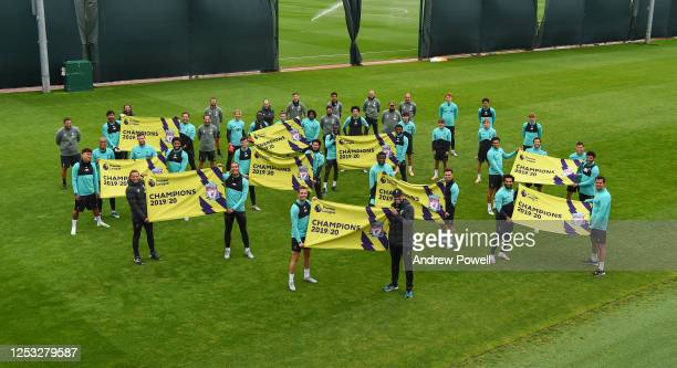 Liverpool Football club players and staff pose for a photograph before a training session at Melwood Training Ground on June 29 2020 in Liverpool...
