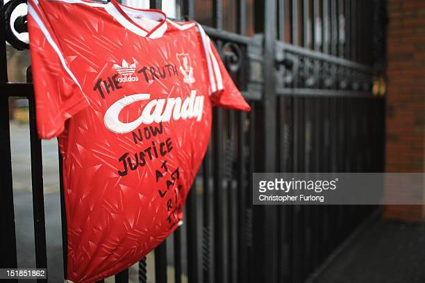 Liverpool Football Club shirt with 'The Truth Now Justice At Last RIP The 96' is tied to the Shankly gates at Anfield stadium after the publication...
