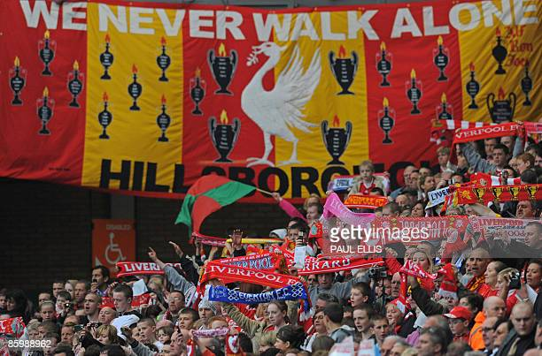Liverpool football club supporters sing 'You'll Never Walk Alone' during a memorial service to mark the twentieth anniversary of the Hillsborough...