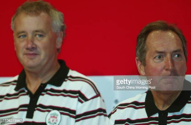 Liverpool Football Club's chief executive Rick Parry and manager Gerard Houllier attend the welcoming press conference at Grand Hyatt 25 July 2003