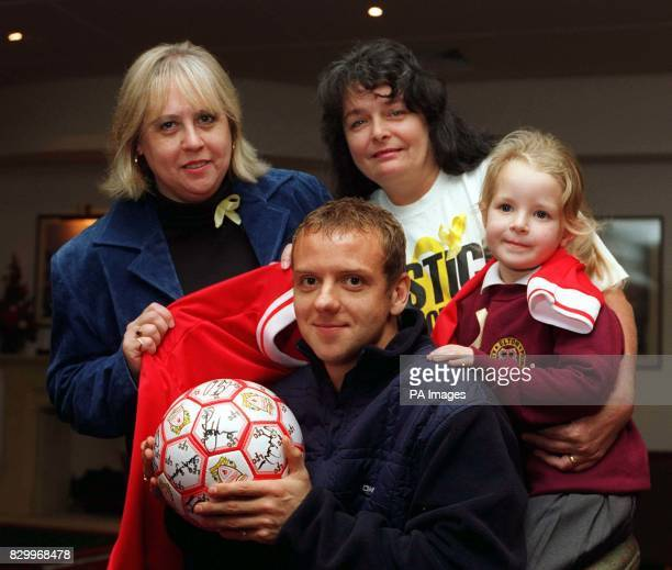 Liverpool Football Club's Rob Jones joins his young cousin Nicola Stubbs aged four a pupil at Elton Primary School and campaign group members...