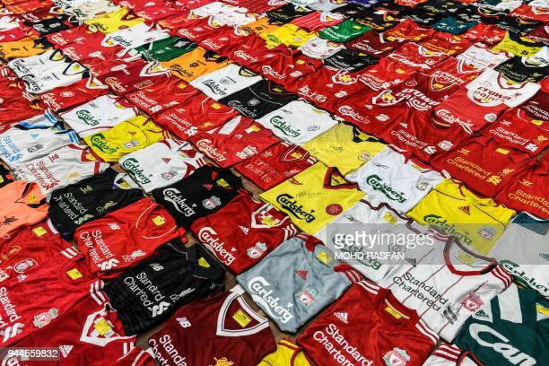 Liverpool football jerseys are displayed side by side during the Malaysia Book of Records event for the most number jerseys on display of a single...
