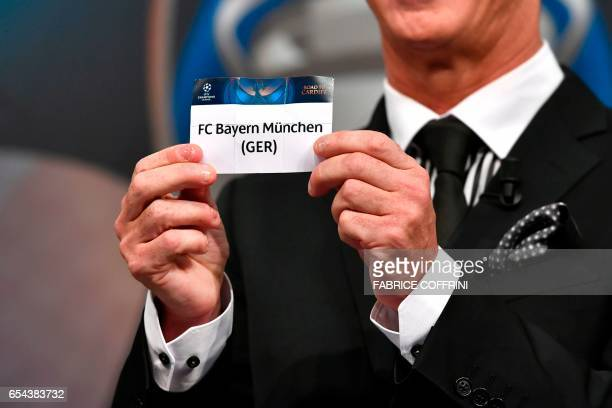 Liverpool football legend and UEFA Champions League Final Ambassador Ian Rush shows a piece of paper bearing the name of FC Bayern Munchen during the...