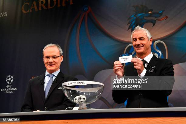 Liverpool football legend and UEFA Champions League Final Ambassador Ian Rush shows a piece of paper bearing the name of Real Madrid CF next to UEFA...