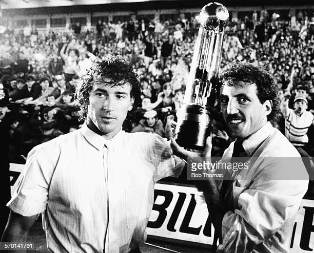 Liverpool football players Craig Johnston and Alan Kennedy hold the Canon League Championship Trophy after their team drew against Norwich City in...