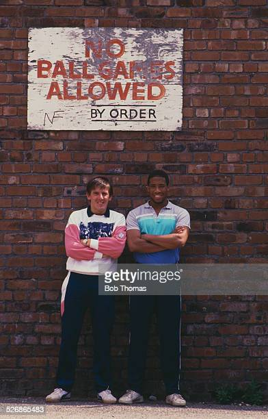 Liverpool footballers John Barnes and new signing Peter Beardsley outside Anfield football stadium in Liverpool 1987 Above them is a sign reading 'No...