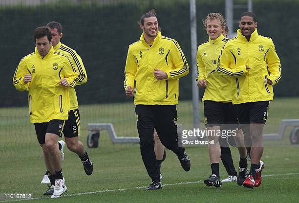 Liverpool forward Andy Carroll in good spirits with team mates Dirk KuytGlen Johnson and Joe Cole during a training session ahead of their UEFA...