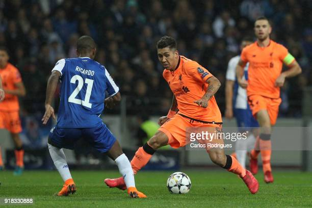 Liverpool forward Roberto Firmino from Brazil tries to pass trough FC Porto defender Ricardo Pereira from Portugal during the UEFA Champions League...
