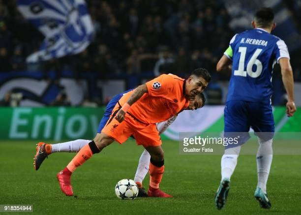 Liverpool forward Roberto Firmino from Brazil with FC Porto defender Diego Reyes from Mexico in action during the UEFA Champions League Round of 16...