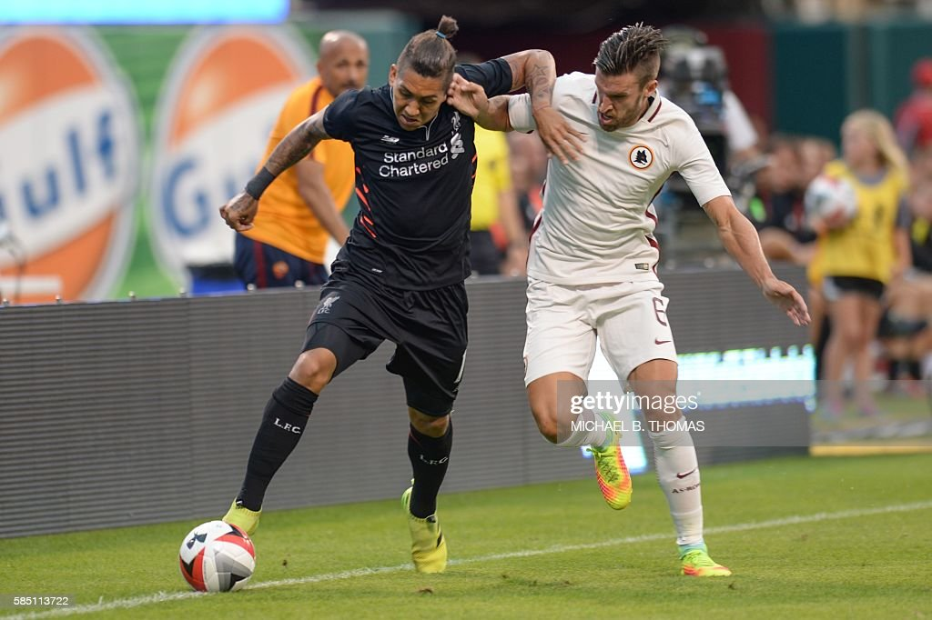 Liverpool forward Roberto Firmino (11) vies for the ball against Roma midfielder Kevin Strootman (6) during their friendly soccer match at Busch Stadium in St. Louis, Missouri on August 1, 2016. / AFP / Michael B. Thomas