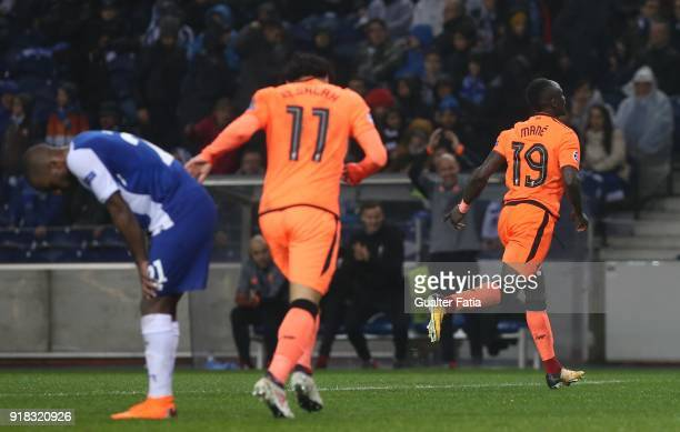 Liverpool forward Sadio Mane from Senegal celebrates after scoring a goal during the UEFA Champions League Round of 16 First Leg match between FC...
