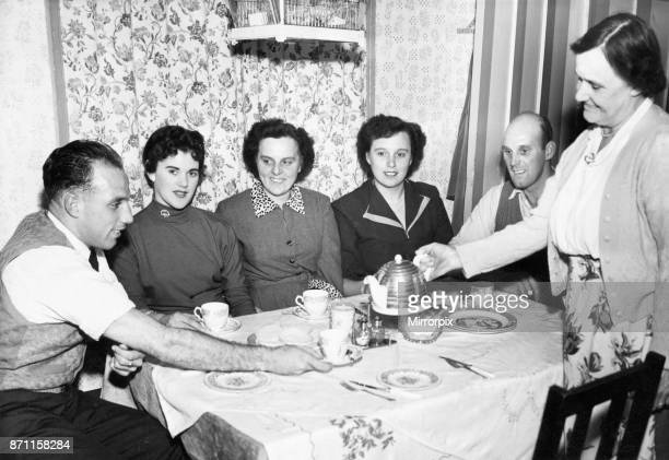 Liverpool full back Ronnie Moran has a cup of tea poured for him bis mother at home. Waiting their turn are his girfriend Joyce, his sisters Dixie...