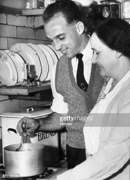 Liverpool full back Ronnie Moran sampling the cooking of his mum in the kitchen at home, 26th October 1955.