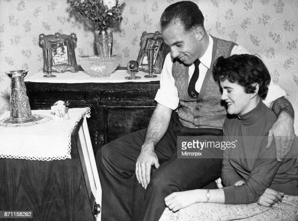Liverpool full back Ronnie Moran with his girlfriend Joyce watching television at home on their Wednesday night television night 26th October 1955