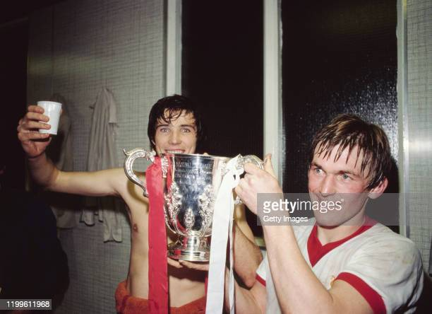 Liverpool goal scorer's Alan Hansen and Kenny Dalglish celebrate with the trophy in the dressing room after the 1981 League Cup Final replay victory...