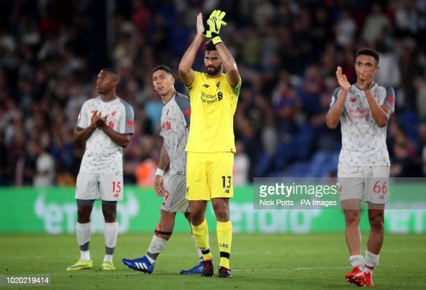 Liverpool goalkeeper Alisson Becker applauds the fans after the Premier League match at Selhurst Park London