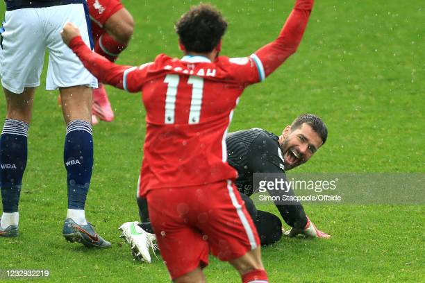 Liverpool goalkeeper Alisson Becker celebrates scoring a last minute winning goal during the Premier League match between West Bromwich Albion and...