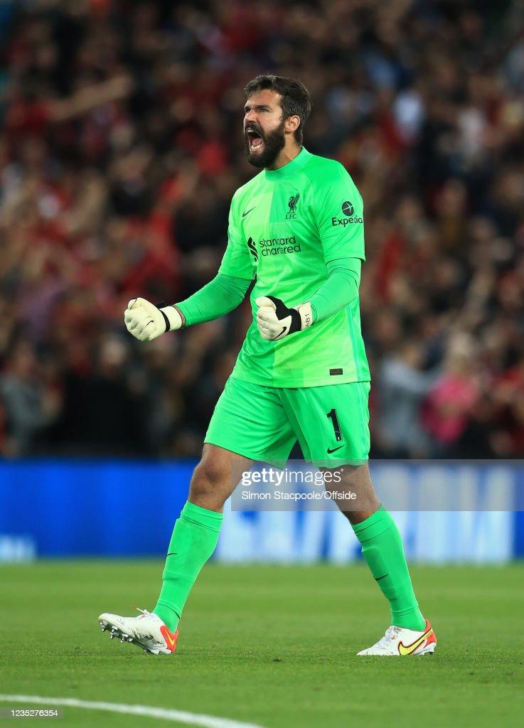 Liverpool goalkeeper Alisson Becker celebrates the opening ...