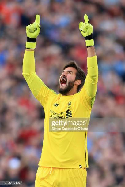 Liverpool goalkeeper Alisson Becker celebrates their 1st goal during the Premier League match between Liverpool and Brighton Hove Albion at Anfield...