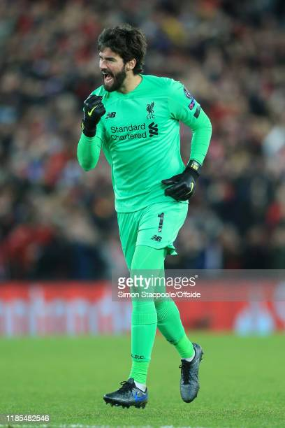 Liverpool goalkeeper Alisson Becker celebrates their goal during the UEFA Champions League group E match between Liverpool FC and SSC Napoli at...