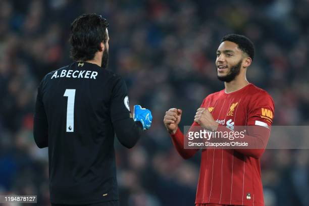 Liverpool goalkeeper Alisson Becker celebrates victory with Joe Gomez of Liverpool after the Premier League match between Liverpool FC and Manchester...