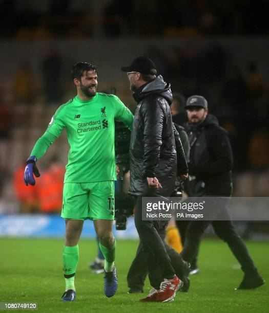 Liverpool goalkeeper Alisson Becker celebrates with Liverpool manager Jurgen Klopp after 20 win during the Premier League match at Molineux...
